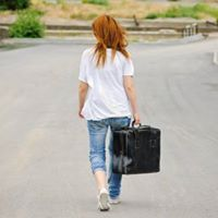 Girl walking with suitcase