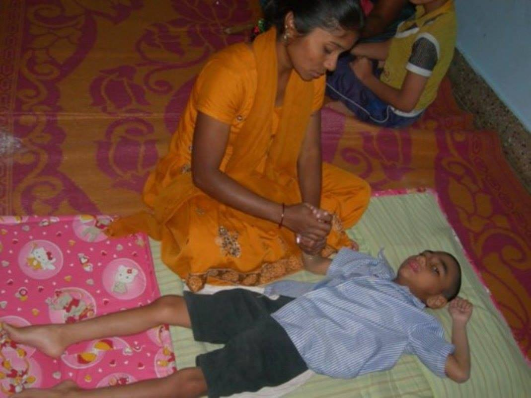 Mother carrying out physiotherapy